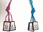 small pink or blue scapular